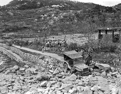 Sunday drive in Korea, gone bad! November 1945, photographer Rolland Oxton of the Boston  Herald said simply: On a Sunday afternoon in Korea during November 1945, three of us--all  photographers-- drove down this road. We reached a point where even our trusty Jeep couldnt go any farther.