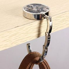 Cheap purse hook, Buy Quality bag hanger directly from China handbag holder Suppliers: New Metal Foldable Bag Purse Hook Bag Hanger/Purse Hook/Handbag Holder Shell Bag Folding Table Popular Diy Purse Hanger, Purse Holder, Hangers, Purse Storage, Purse Hook, Diy Supplies, Cute Purses, Practical Gifts, Womens Purses