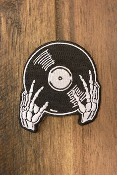 embroidered black & white patch w/ iron-on backing. X a hand drawn illustration of skeleton hands holding up a vinyl record. Perfect addition to your favorite vinyl lovers massive collection. Punk Patches, Diy Patches, Cool Patches, Pin And Patches, Iron On Patches, Jacket Patches, Vintage Embroidery, Embroidery Patterns, Hand Embroidery