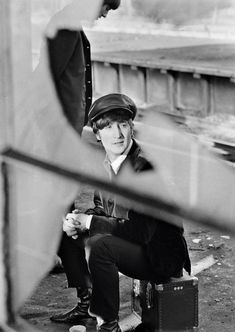 David Hurn |  G.B. ENGLAND. LONDON. The BEATLES during filming of 'A Hard Days Night'. The Beatles film was primarily shot on a moving train. John Lennon on train platform. 1964.
