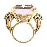 Morganite Ring  American  Retro - 1940's  Boldly featuring a 48.25 carat vivacious pink morganite flanked by 14k rose gold scrolls enhanced in typical Retro fashion by round-cut rubies and round brilliant-cut diamonds.