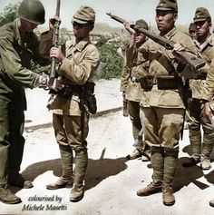 #WW2ColourisedPhotos ..... Japanese soldiers, armed with Arisaka Type 99 rifles, surrender to American troops in Keijo (now Seoul), Chosen (now Korea) in September 1945.