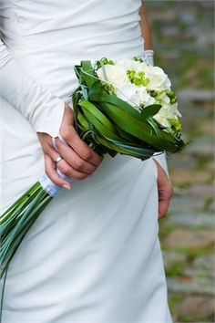 love the greenery-- white and green bridal bouquet