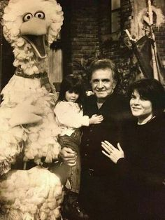 Johnny Cash, his daughter, grand daughter, and Big Bird.