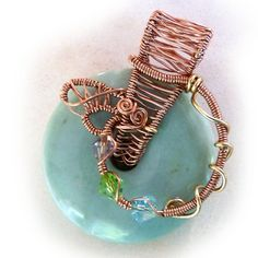 Aqua Wire Weave Donut Pendant  Simple and beautiful. This lovely, light teal gemstone donut (I pretty sure it's amazonite) is wrapped in flowing copper and bronze. The bail is hand woven. The feel of the piece is of waves on a foamy blue-green sea.