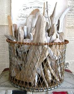 Rustic trap type basket filled with driftwood