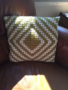 Granny square crochet cushion that made in Stylecraft DK