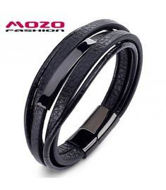 ee2932a42343 Fashion hombres encanto clásico simple pulseras de cuero pulseras de acero  inoxidable iman hebilla pulsera -
