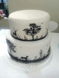 Hand painted black and white hunting scene silhouette 2 tier wedding cake