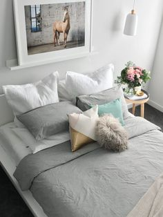 Love this bedding look we created using bamboo sheets. Grey, washed out green and blush pink colour palette in this relaxed luxe bedroom. Beautiful limited edition horse print by Grace Costa and large fresh blooms from Barton Flower Bar. Feature cushions available at Style Curator Store.