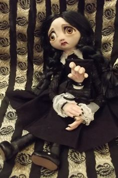 Wednesday Addams doll (with Thing) by Clementines Creepies.