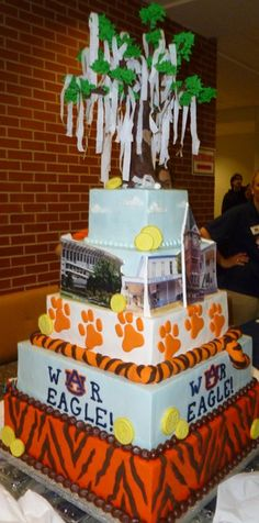 Grooms cake? Minus the fourth & fifth layers. Add a houndstooth layer in there for House Divided. :)