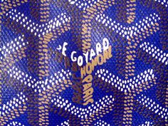 The trademark geometric design & Goyard logo is painstakingly painted by hand, attributing to the cost