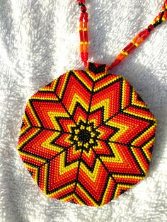 Done with size 15 Rocaille beads. Fire color medallion and necklace. Necklace has DNA style beadwork as well as bugle beads with three strands. Approximately hours put into from start to finish. Beaded Earrings Native, Beaded Earrings Patterns, Native Beadwork, Native American Beadwork, Beading Patterns, Bag Crochet, Beadwork Designs, Native American Crafts, Beading Techniques