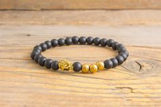 Matte black onyx beaded stretchy bracelet with gold by GAALco