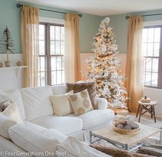 The white pine tree on the shelf, faux fur pillows, faux animal skin rug, faux fur throw and gold textured pillows