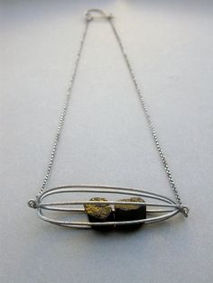 cage pod container rattle necklace modern contemporary art jewelry everday necklace statement necklace black tourmaline