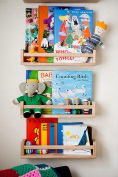 Children's book shelf using IKEA spice racks via WeeBirdy.com