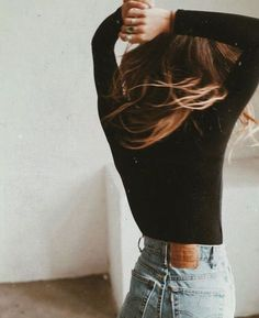 this looks like just a plain fitted black long sleeve tee tucked into high waisted light wash jeans- which is a super cute look