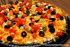 Layered Taco Dip.  I make this for showers and parties and it's always a huge hit.  Layers:  refried beans, guacamole, sour cream with taco seasoning mixed in, shredded cheese, lettuce, tomatoes, green onions, olives, jalapenos.  Dig in!