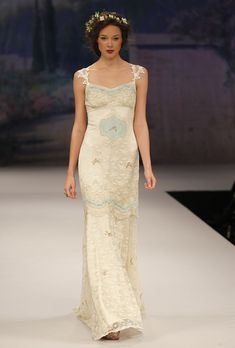 The details on this dress are amazing. Robin's egg blue on cream is so quaint! All these runway dresses are by Claire Pettibone.