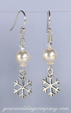 These winter-themed bridal or bridesmaid earrings feature Swarovski pearls, a silver snowflake charm, Swarovski crystals and silver findings. YWC Bridal Jewelry.