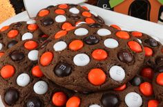 Halloween M&M Cookies - super delicious, easy to make and chock full of M&M's. These cookies are a yummy Halloween cookie that the entire family will love. This is a Halloween dessert that will wow the guests at your Halloween party. Pin this delicious Halloween treat for later and follow us for more great Halloween Food Ideas.
