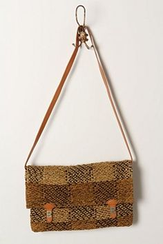 Raffia. But beautiful leather finitions. Anthropologie.