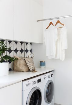 Modern laundry with black and white feature tiles in coastal home on Sydney's northern beaches. Modern Coastal, Mid-century Modern, Spotted Gum Decking, Crazy Paving, Couple Sleeping, Green Armchair, Mid Century Armchair, Cosy Corner, Feature Tiles