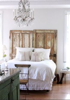 DIY headboards LOVE the doors! I love how it goes to the floor and how it is wider than the bed....BIG white feather down comforter! and some teal pillows ;-)