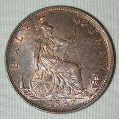 Description: A beautiful nicely toned in red and brown colors about uncirculated or much better bronze coin from Great Britain. This is the 1887 half penny bron