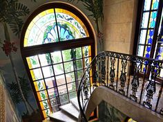 Inside Miami's famous Versace mansion there are plenty of opulent details throughout the home, like these stained glass windows, wall frescoes, and intricate staircase railing. Versace Miami, Versace Home, Staircase Railings, Stairways, Gianni Versace, Casa Casuarina, Versace Mansion, Expensive Houses, Window Design