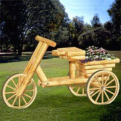 """Trike Timber Planter Plan.  Impress your neighbors and friends with this beautiful self-standing planter out on your front yard. Unique, and easy to build from standard landscape timber and plywood. 46-1/2""""H x 27""""W x 77""""D  Plan #2264  $14.95"""