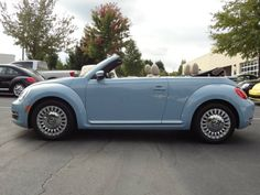 2014 vw beetle convertible light blue - lovin' the new body shape of the vw beetle. I love this car!!