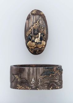 Fuchi-kashira with designs of Fudo sitting in front of a waterfall. Edo period Late 18th–early 19th century - Tetsugendo Naoshige (Japanese, died in 1780) http://www.mfa.org/collections/object/fuchi-kashira-with-designs-of-fudo-sitting-in-front-of-a-waterfall-12519