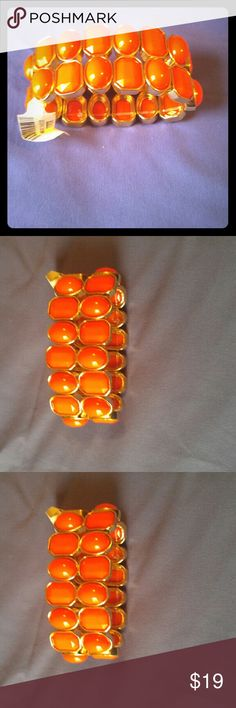 New Cache orange bracelet with gold trim Beautiful solid orange and gold bracelet -Never used !! Cache Accessories