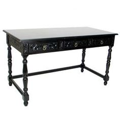 """Wood desk with drawers and turned detailing.    Product: Desk   Construction Material: Wood   Color: Distressed dark brown   Features:  Carved and textured with a smooth finish  Brass hardware  Strong and durable      Dimensions: 30"""" H x 54"""" W x 36"""" D"""