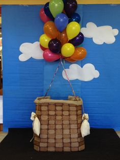Hot air balloon basket made out of strips of woven cardboard.