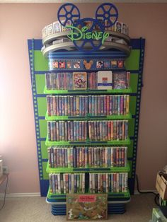 """""""I was told you would like this. It's my mom's Disney movie collection. She isn't missing many, and even has the Sing-Alongs on the side of this case"""" THIS IS JUST DISNEY GOALS 😍 Disney Frozen, Walt Disney, Deco Disney, Disney Fun, Disney Magic, Disney Pixar, Disney Ideas, Disney Home Decor, Disney Crafts"""