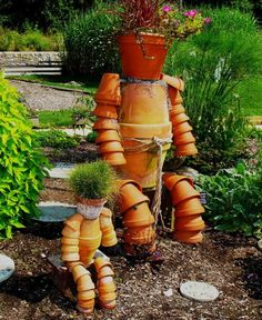 Terra Cotta Clay Pot Garden Person... I saw this once traveling in the south. Very cute