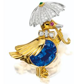 A tanzanite, gold, diamond, and ruby duck brooch by Tiffany and Co.