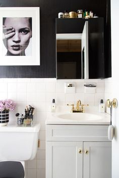 A Teen Vogue Editor's Stylish Rental Bathroom Upgrade on a Budget featuring @lowes! via sohautestyle.com