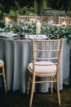 ... from the photo shoot taken by Foto Memories , focusing on muted tones in greys and using the foliage only garland. Co-ordination used a round table, ...
