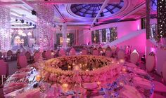 round table with flowers and carousel centerpiece