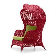 What a neat chair. I love how it has a sort of canopy...it'd make me feel all wrapped up and cozy!