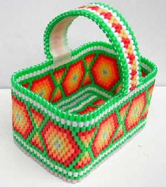 Basket Nabbi perler beads by Emos Pärlkonst - This basket is composed of three bands of different sizes. They are sewn together and the handle is reinforced with masking tape. Perler Beads, Fuse Beads, Melty Bead Patterns, Perler Patterns, Beaded Boxes, Beaded Purses, Beaded Banners, Iron Beads, Melting Beads