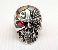 Our Cyborg Skull Ring will dramatically bolster your biker look. You can clearly see the reference to Terminator in its red ruby eye. Made from sterling silver Gothic Wedding Rings, Skull Wedding Ring, Victorian Engagement Rings, Gothic Rings, Skull Jewelry, Gothic Jewelry, Skull Rings, Crane, Sterling Silver Diamond Rings