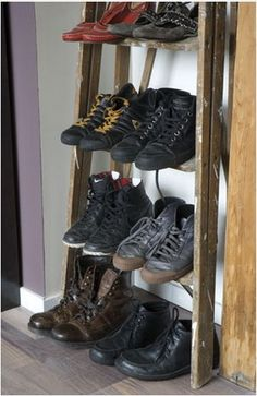 boots on shelves made of old ladder