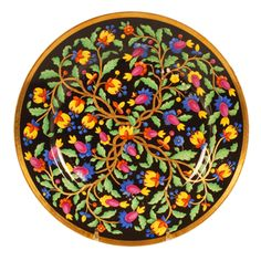 A Russian porcelain plate by the Imperial Porcelain Factory, Nicholas I period (1825-1855). The center of the overall patterned plate decorated with foliage and stylized flower heads against a black ground within a gilt border.