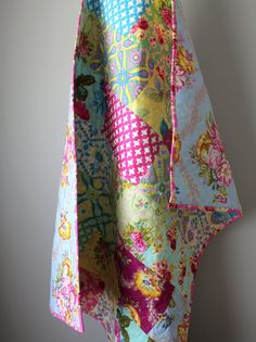 The beautiful baby girl quilt is completed and ready to ship to you! This quilt features a beautiful mix of modern geometric and traditional floral